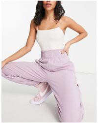 Bershka Joggers oversize rosa con fascia