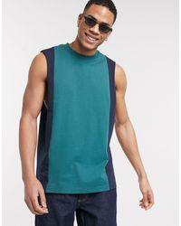 ASOS – Ärmelloses T-Shirt mit tiefen Armlöchern und vertikalen Bahnen - Blau