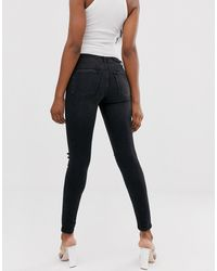 NA-KD Distressed Skinny Jeans Met Normale Taille - Blauw