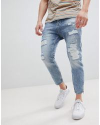 Stradivarius - Carrot Fit Jeans With Zips And Abrasion In Light Blue - Lyst