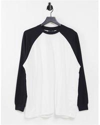 ASOS T-shirt oversize à manches longues raglan contrastées - Blanc et noir