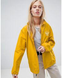 Herschel Supply Co. Herschel Voyage Packable Coach Jacket Back Logo Print In Yellow