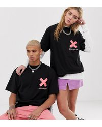 Collusion Camiseta unisex con logo en flúor rosa - Negro