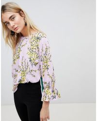 Warehouse - Floral Burst Flute Sleeve Blouse - Lyst