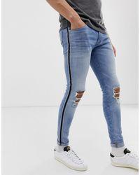 Jack & Jones Intelligence – Spray On – Enge Jeans mit Knierissen und Seitenstreifen, - Blau