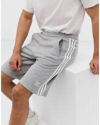 adidas Originals Серые Шорты С Тремя Полосками Adicolor-серый