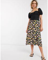 Warehouse Falda midi con abertura y estampado floral en negro