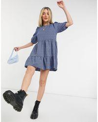 New Look Vestido corto a cuadros azules amplio estilo babydoll con manga abullonada
