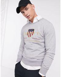 GANT – Archive – meliertes Sweatshirt mit Rundhalsausschnitt und gesticktem Wappen-Logo - Grau