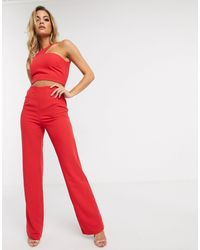 Vesper - Tuta jumpsuit rossa con cut-out - Lyst