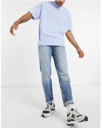 ASOS - Jeans regular lavaggio blu medio slavato - Lyst