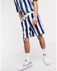 Lacoste Pantalones cortos azul marino con logo en recuadro y diseño a rayas L!VE