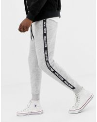 Hollister Side Taped Logo Slim Fit Cuffed jogger In Grey Marl