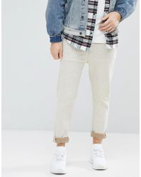 ASOS DESIGN - Asos Tapered Jeans In Ecru Nep - Lyst