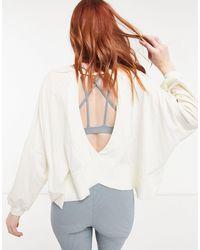 Onzie Om - Top a maniche lunghe da yoga color avorio - Bianco