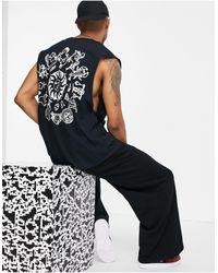 Honour Hnr ldn - t-shirt sans manches avec motif astrologie imprimé au dos - Noir