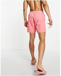 ASOS Swim Shorts With Contrast Stitching And Acid Wash Mid Length - Pink