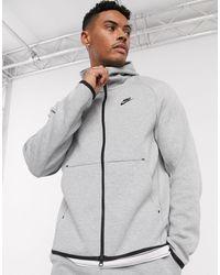 Nike Felpa tecnica con cappuccio e zip grigia - Grigio
