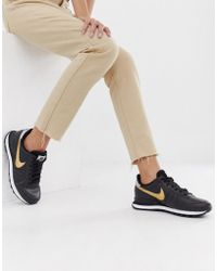 Nike Black And Gold Internationalist Sneakers
