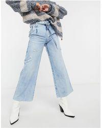 Free People – Kinsey – Kurz geschnittene Jeans - Blau