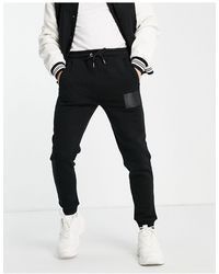 Jameson Carter Leighton Leather Patch Tapered joggers - Black