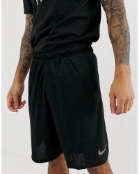 Nike Short de training tissé Dri-FIT 23 cm pour - Noir