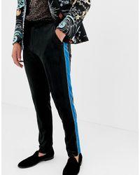 ASOS – Enge, elegante Hose aus schwarzem Samt mit blauem Seitenstreifen