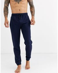 Tommy Hilfiger Lounge Tapered Trackies With Flag Logo - Blue