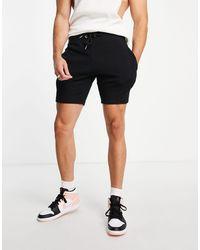ASOS Shorts negros ajustados