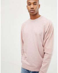 ASOS Oversized Sweatshirt With Reverse Brushback Sleeves In Pink