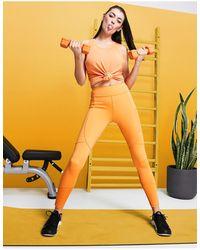 ASOS 4505 Leggings con detalle - Naranja