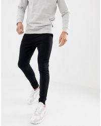 Lyst - Pantalon de jogging skinny moulant boutons-pression The ... 4253dd30913