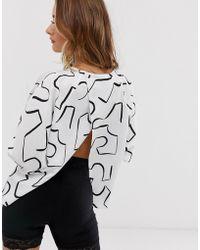 ASOS Top manches chauve-souris avec dos drapé et imprimé abstrait - Multicolore