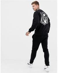 ASOS Oversized Sweatshirt With Nfl Embroidery And Back Print - Black