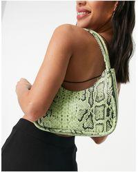 Monki Ebbis - sac porté épaule imitation serpent - Vert