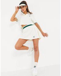 adidas Originals Tennis luxe - gonne a pieghe sporco con logo - Bianco