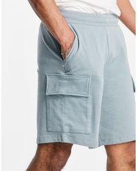 ASOS Oversized Jersey Shorts With Cargo Pocket - Blue