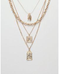 ASOS Collier multi-rangs avec breloques icônes religieuses et Saint-Christophe style vintage - Métallisé