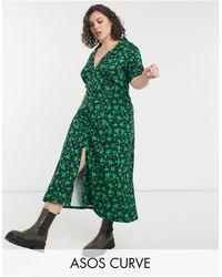 ASOS Vestido de tarde midi negro con estampado floral verde Ultimate de ASOS DESIGN Curve