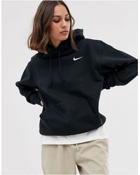 Nike Felpa oversize con cappuccio e logo piccolo nera - Nero