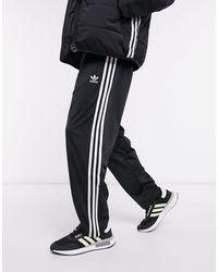 adidas Originals Joggers en negro firebird