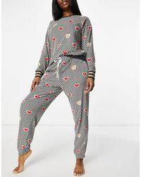 DKNY Velours Loungeset Van joggingbroek En Shirt Met Lange Mouwen Met Allover Hartjes- En Logoprint - Zwart