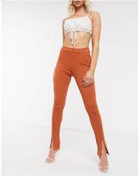 NA-KD - Pantaloni skinny ruggine con spacco sul davanti - Lyst
