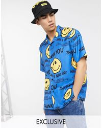 Chinatown Market Chemise à motif smiley déformé - Bleu