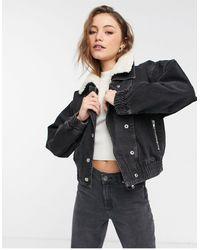 TOPSHOP – Jeans-Skijacke im 80er-Stil mit Teddyfutter - Schwarz
