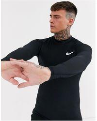 Nike Nike Pro Training - Top baselayer a maniche lunghe nero con collo alto