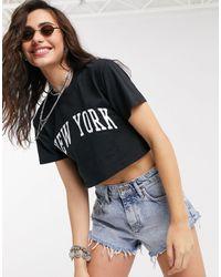 TOPSHOP – es T-Shirt mit Schriftzug im College-Stil - Schwarz