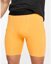 ASOS 4505 – Kurz geschnittene Lauf-Leggings mit Logo - Orange