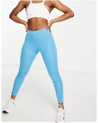 ASOS 4505 Legging avec poche arrière pour téléphone et chevilles zippées - Bleu