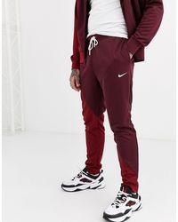 Nike - Swoosh Cuffed joggers - Lyst